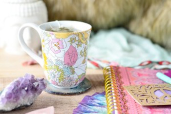 Tea cup with journal